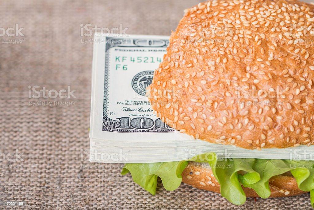 Hamburger with dollar bank notes stock photo