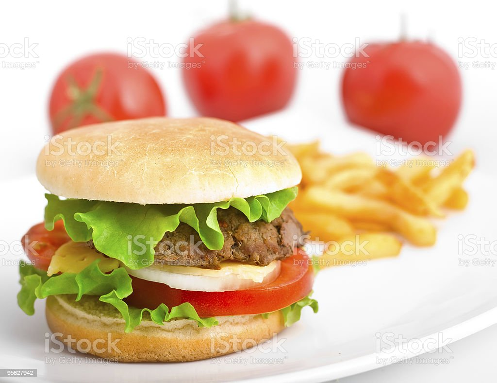 Hamburger with fries and tomatoes royalty-free stock photo
