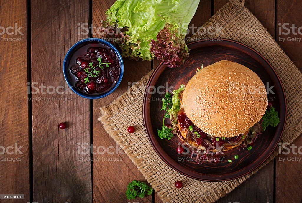 Hamburger with juicy turkey burger with cheese, caramelized onions stock photo
