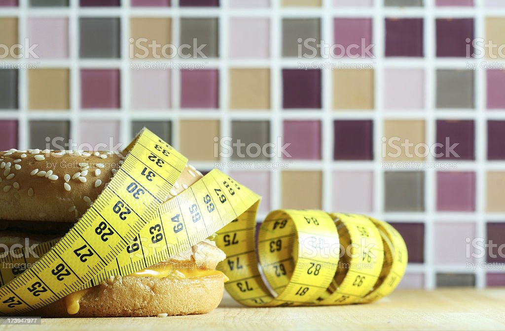 Hamburger with Measuring Tape royalty-free stock photo