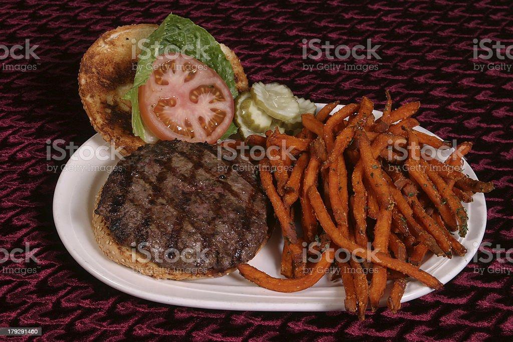Hamburger with sweet potato fries. royalty-free stock photo