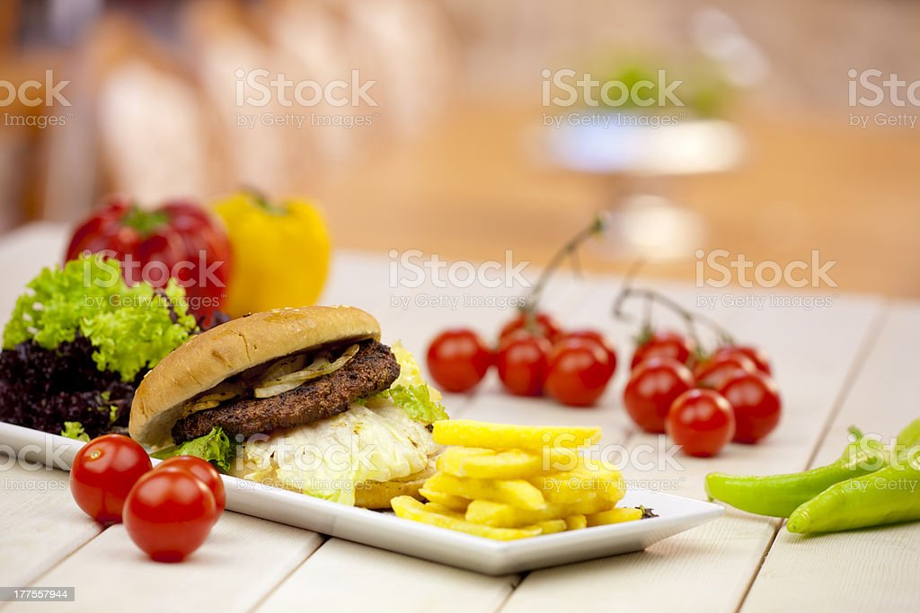 hamburger with vegetables and chips stock photo