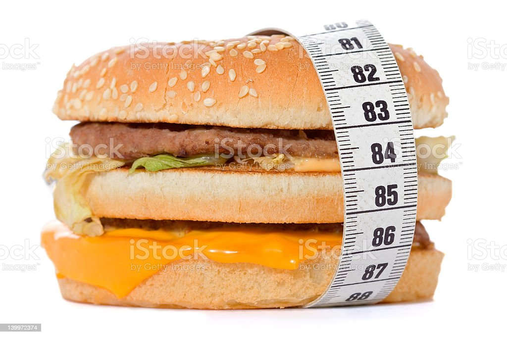 Hamburger wrapped around a measurement tape royalty-free stock photo