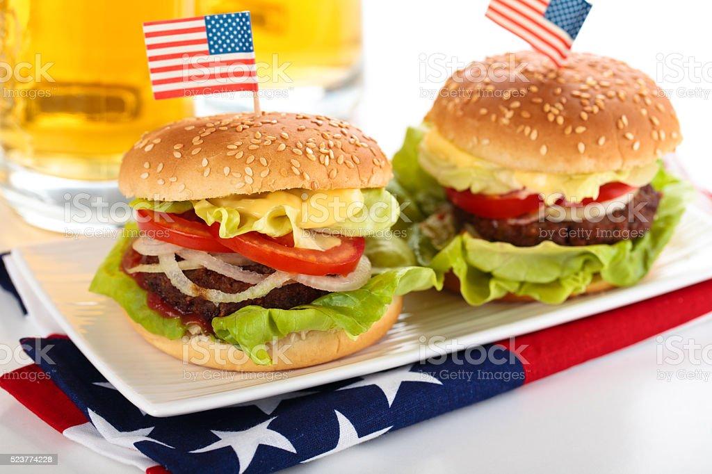 Hamburgers and beer. stock photo