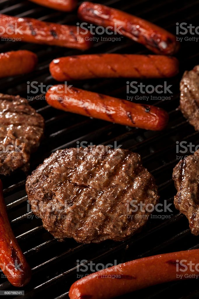 Hamburgers and Hot Dogs on the Grill stock photo