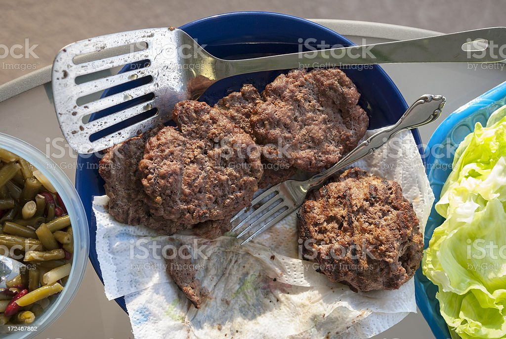 Grilled hamburgers in summertime royalty-free stock photo