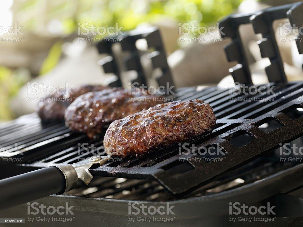 Hamburgers on an Outdoor Grill stock photo