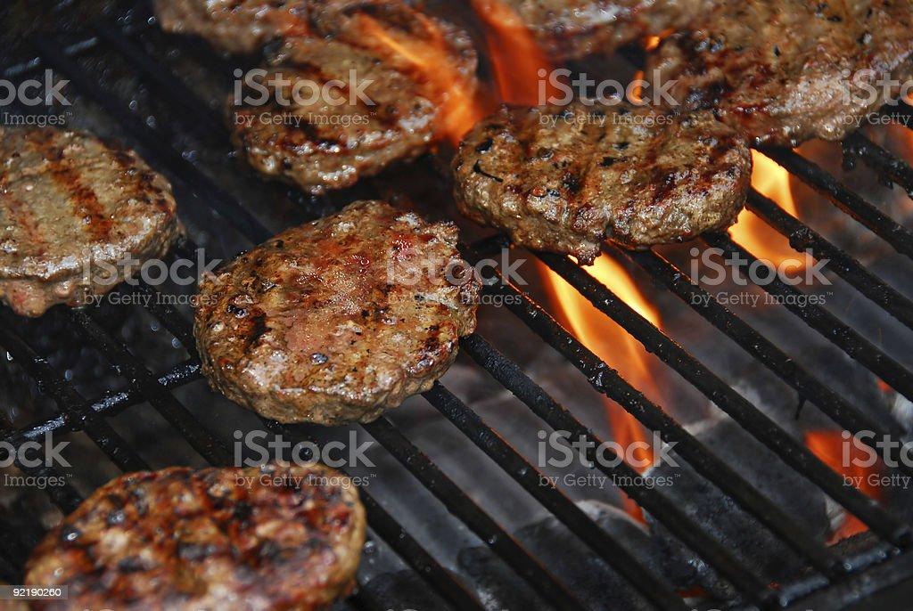 Hamburgers on barbeque royalty-free stock photo