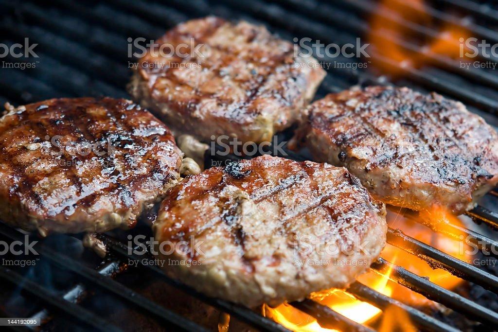 Hamburgers on the grill stock photo