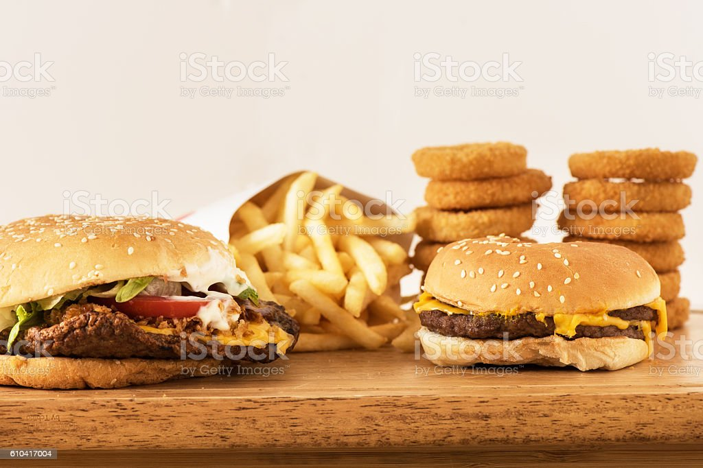Hamburgers  onions and patatos with white background stock photo