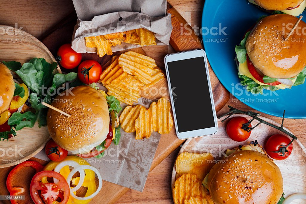 Hamburgers with moblie phone stock photo