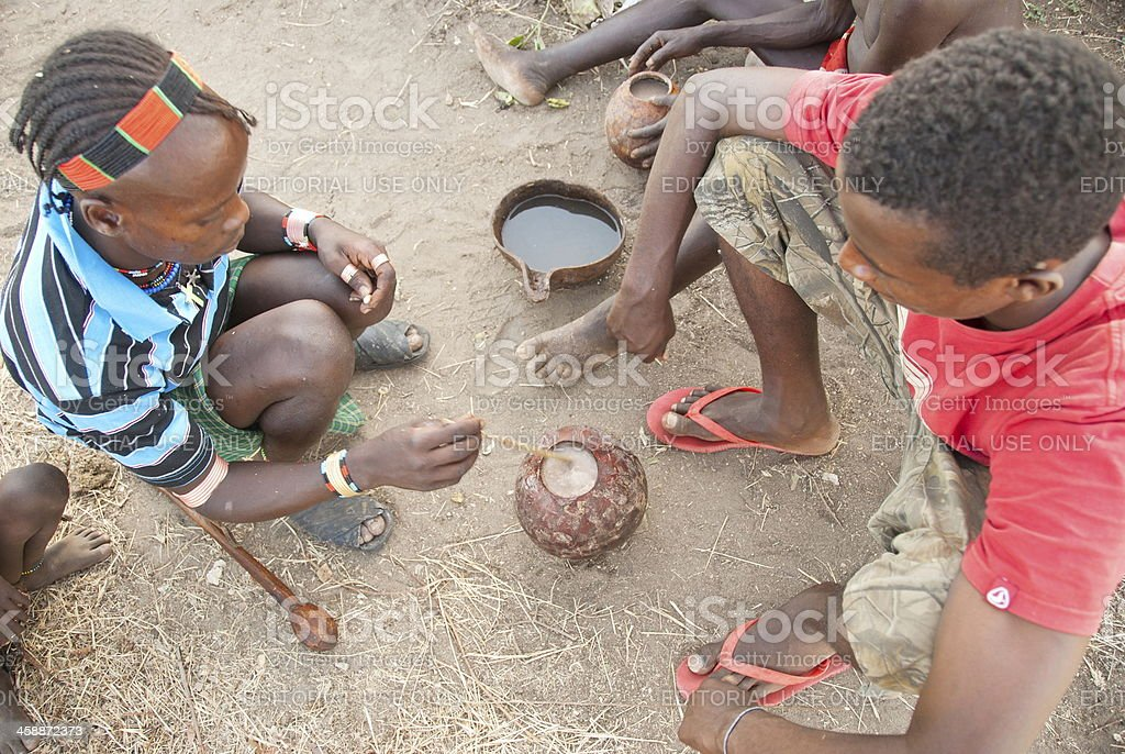 Hamer men drink traditional beer near Dimeka in Valley Omo. stock photo