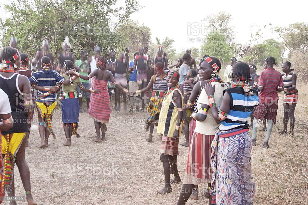 Hamer people dance at festival of initiation for young men. stock photo