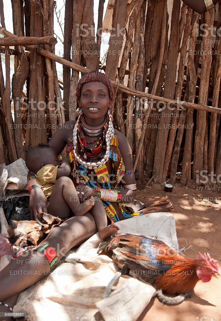 Hamer woman sells poultry at market, Dimeka, Valley Omo, Ethiopia. stock photo