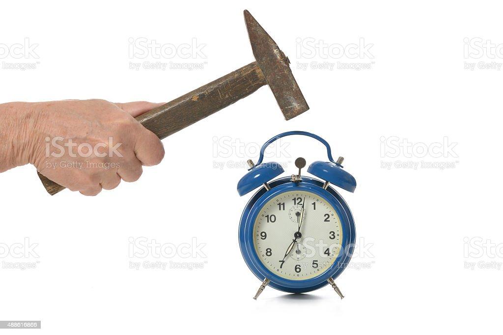 hammer and alarm clock stock photo