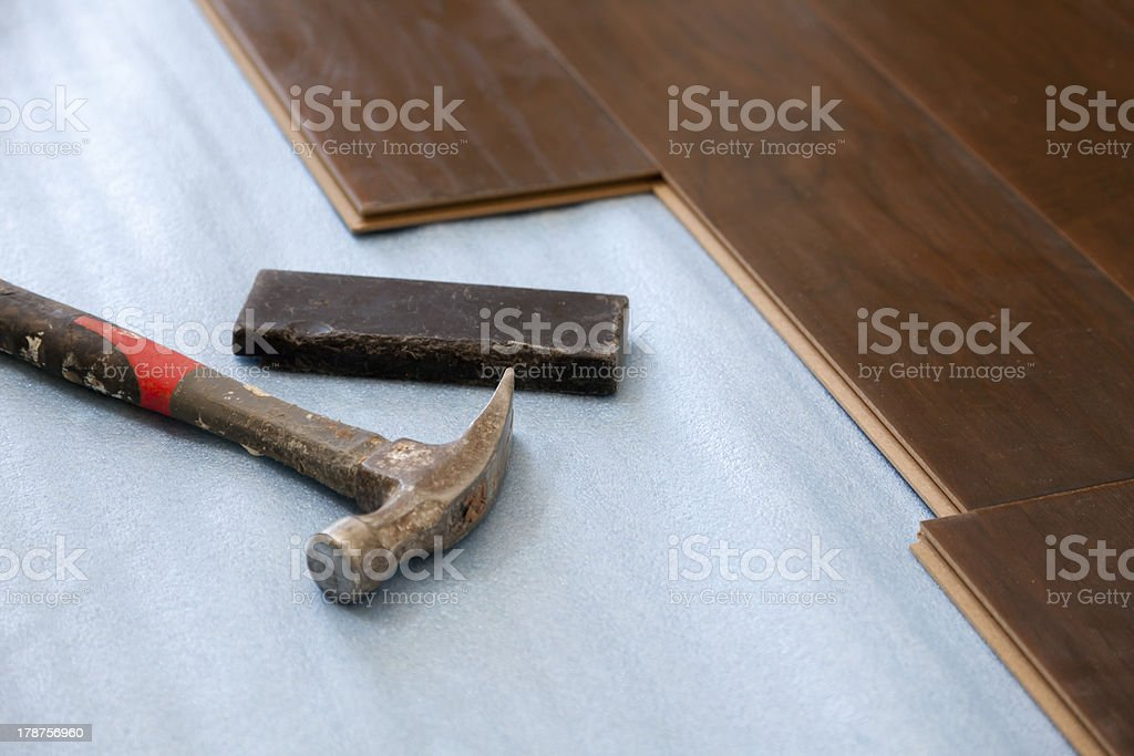 Hammer and Block with New Laminate Flooring royalty-free stock photo