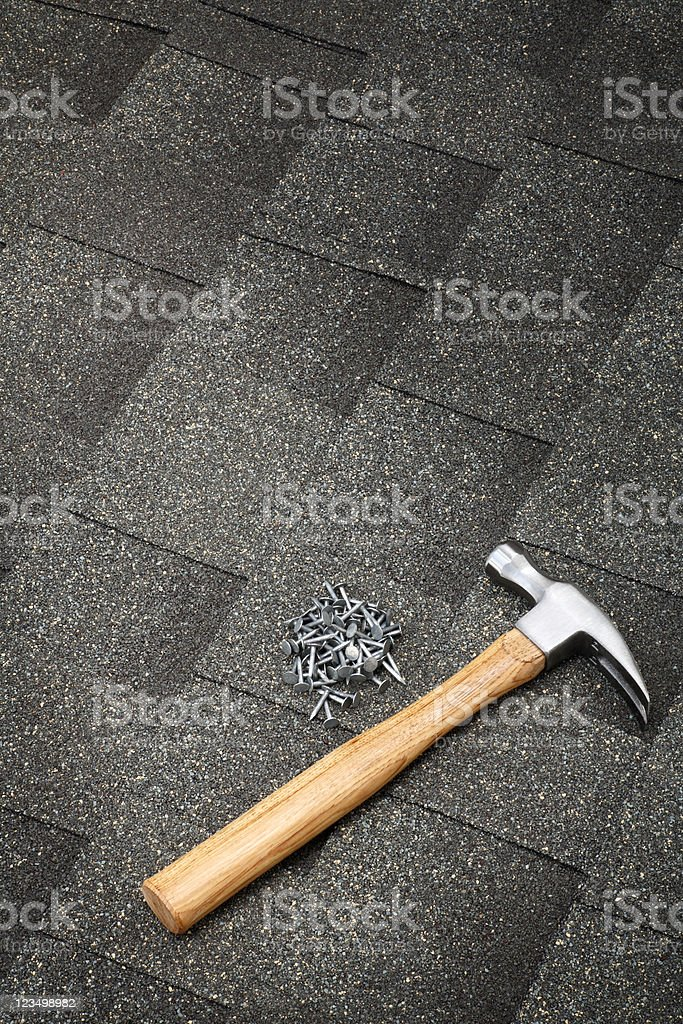 Hammer and Nails on the Roof royalty-free stock photo
