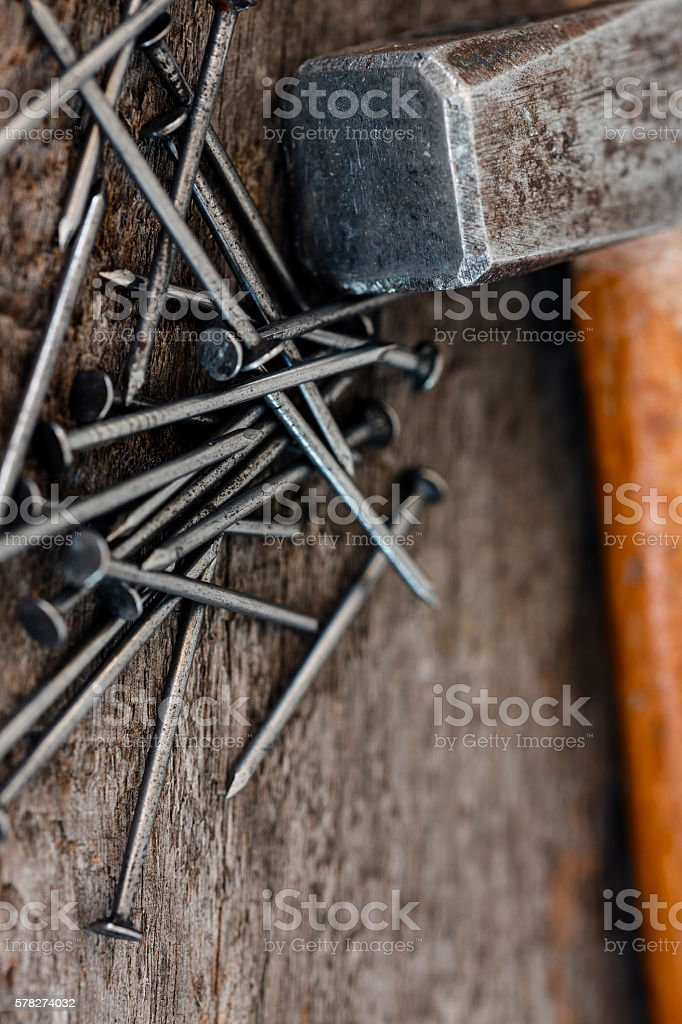 Hammer And Nails On Wooden Background stock photo