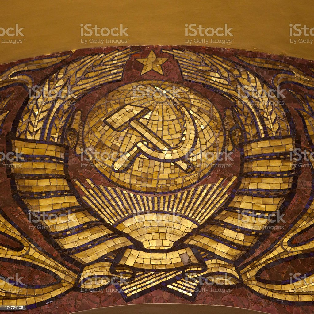 Hammer and Sickle on wall of Komsomolskaya Metro Station, Moscow royalty-free stock photo