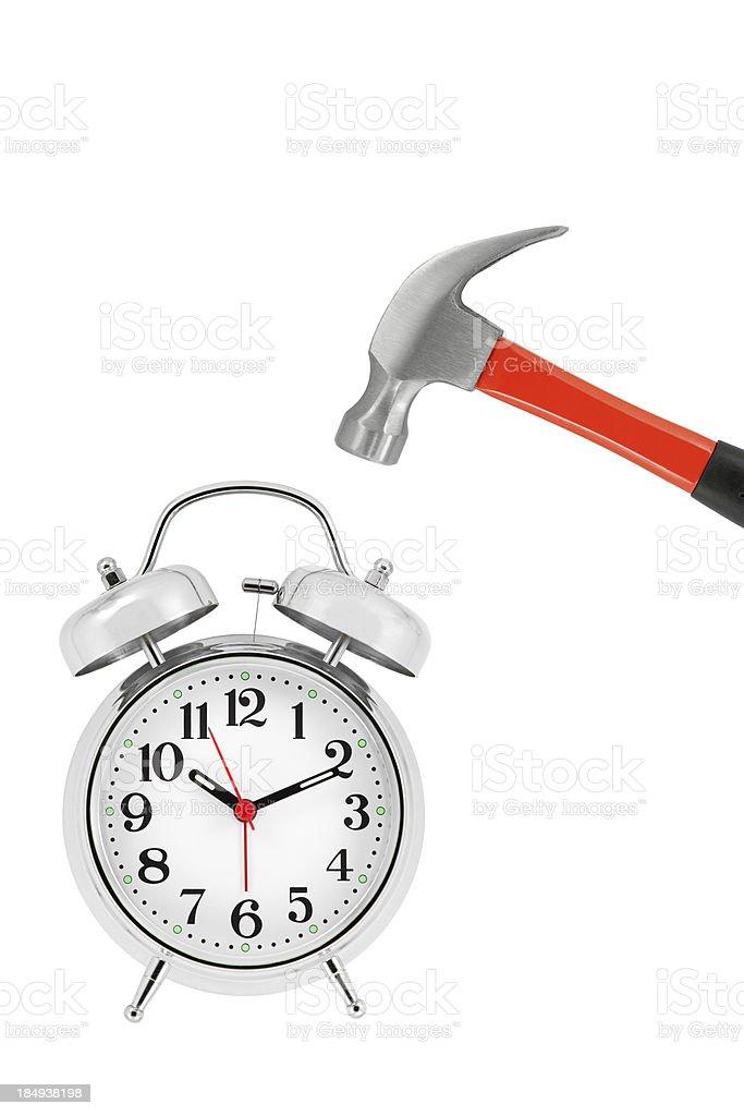 Hammer and silver alarm clock stock photo