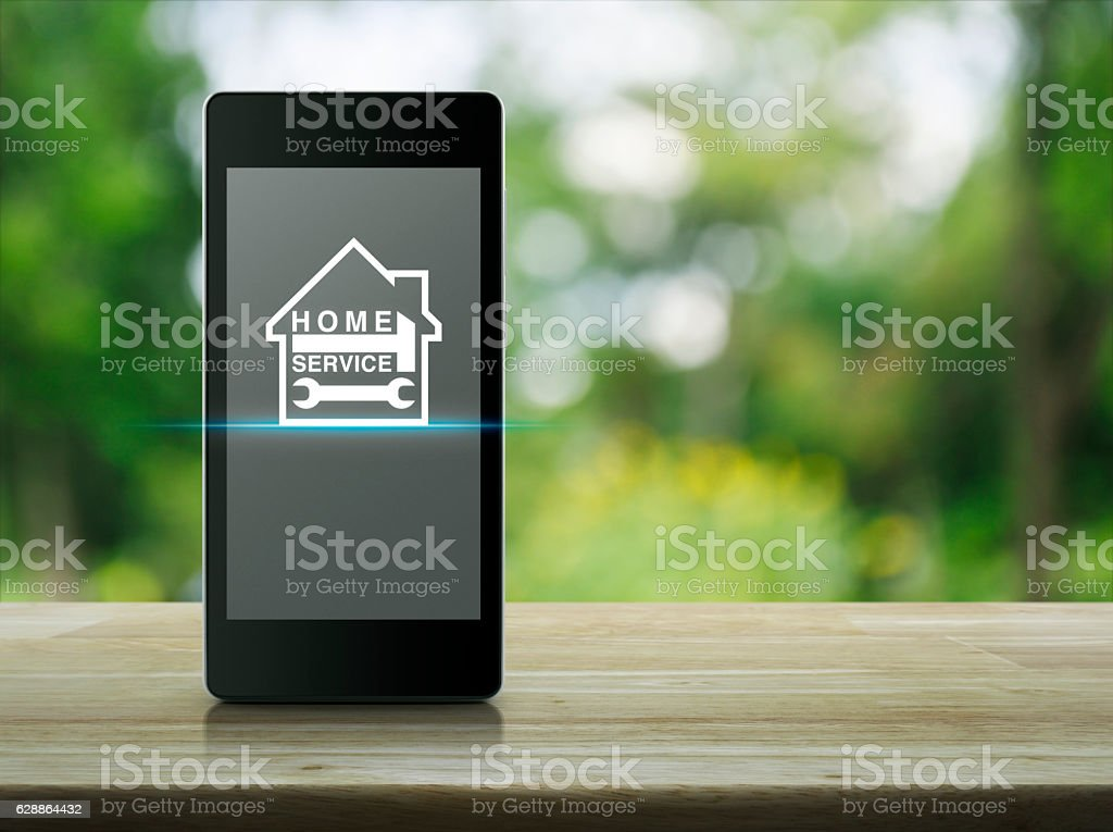 Hammer and wrench with house icon stock photo