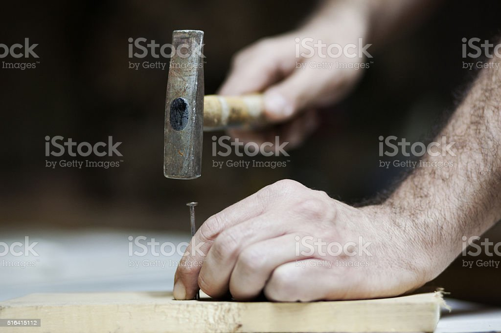 Hammer at work stock photo