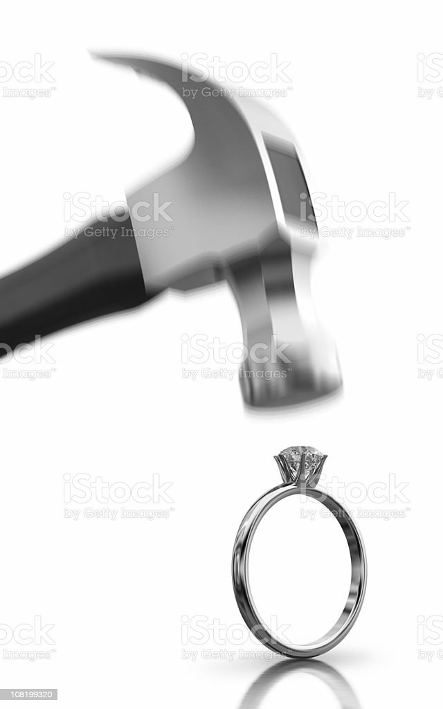 Hammer Coming Down on Wedding Ring stock photo