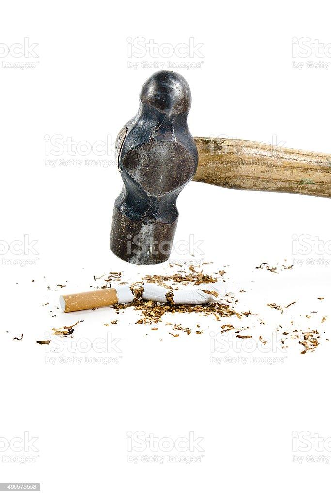 Hammer Destroying Cigarette royalty-free stock photo