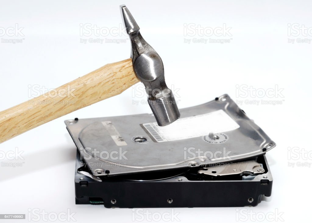 Hammer destroying hard disk drive on a white background stock photo