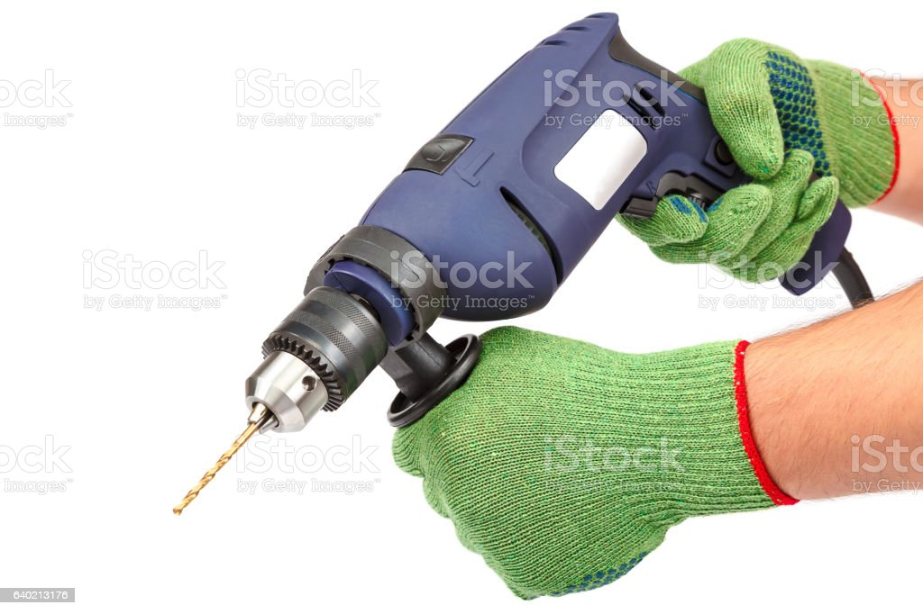 Hammer drill or screwdriver in hand on white stock photo