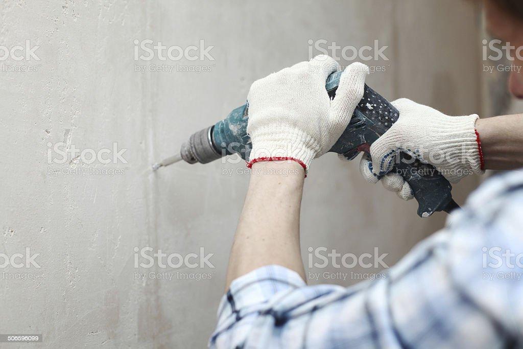 hammer drills wall stock photo