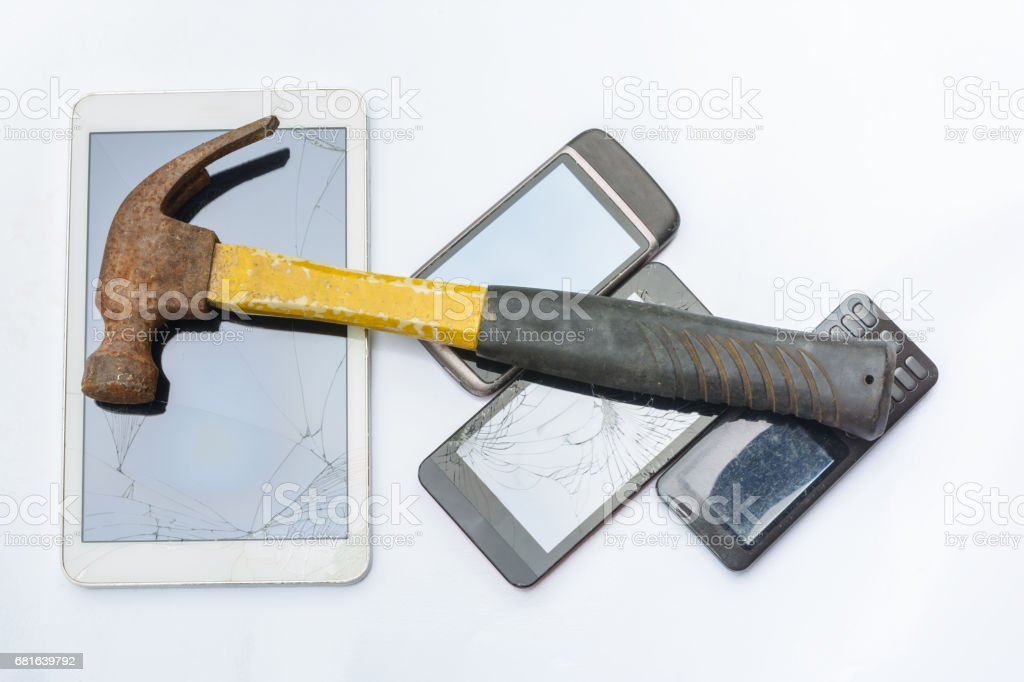 Hammer hit a tablet and smartphone to destroy stock photo