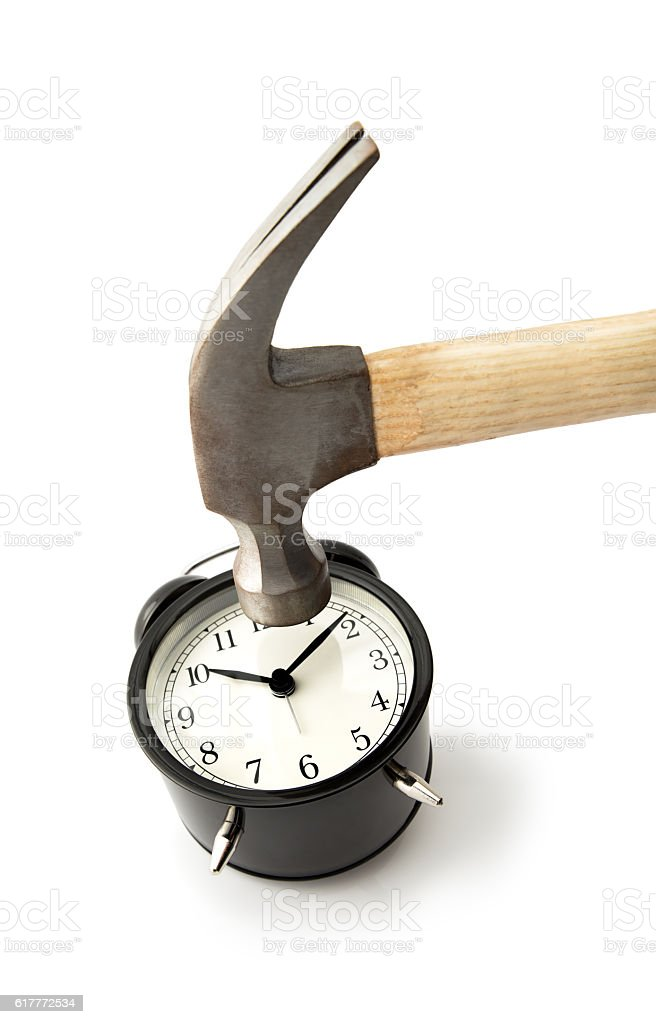 Hammer Hitting Alarm clock stock photo