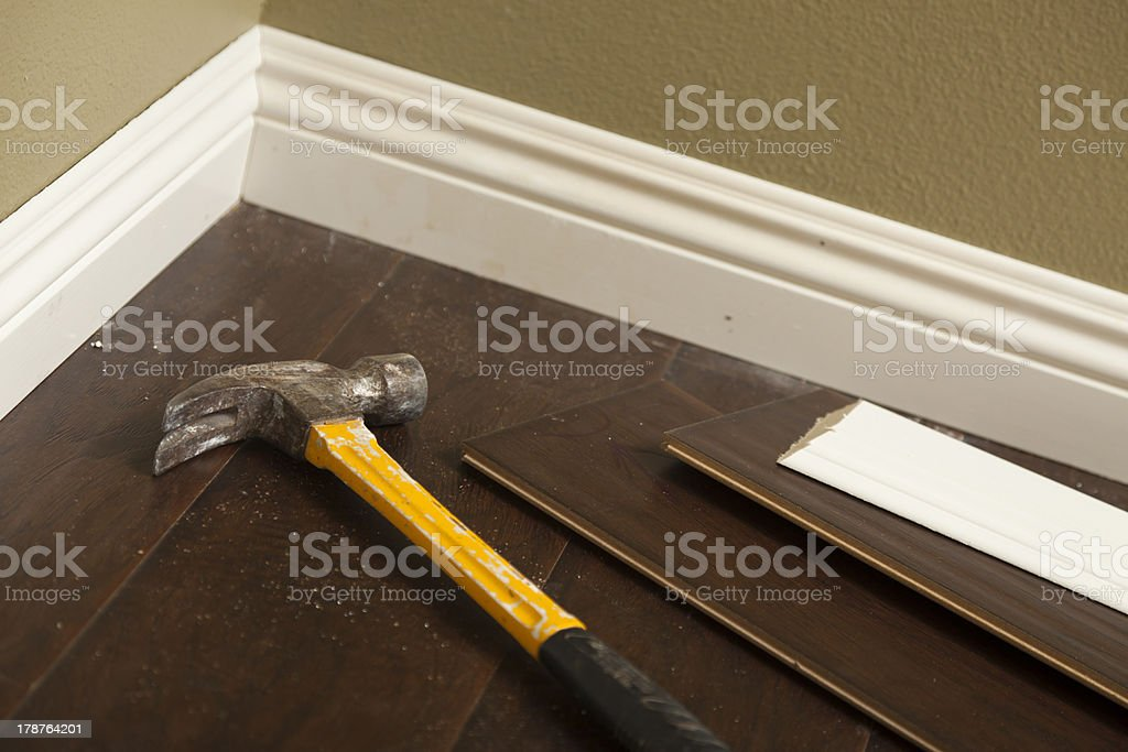 Hammer, Laminate Flooring and New Baseboard Molding royalty-free stock photo