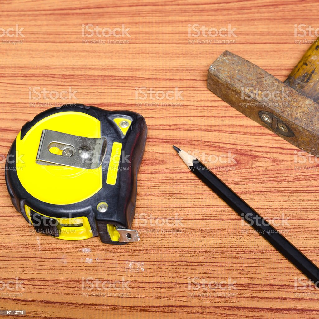 hammer measuring tape and pencil stock photo