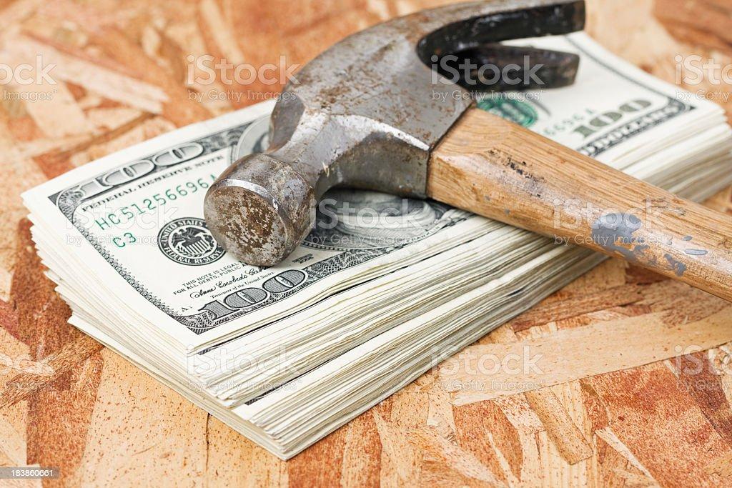 Hammer on Stack of Money stock photo