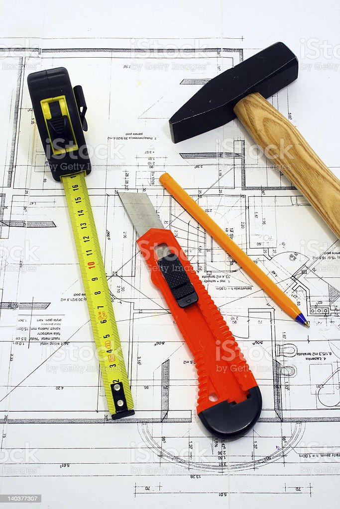 Hammer, penknife, measure and pencil on a blueprint royalty-free stock photo