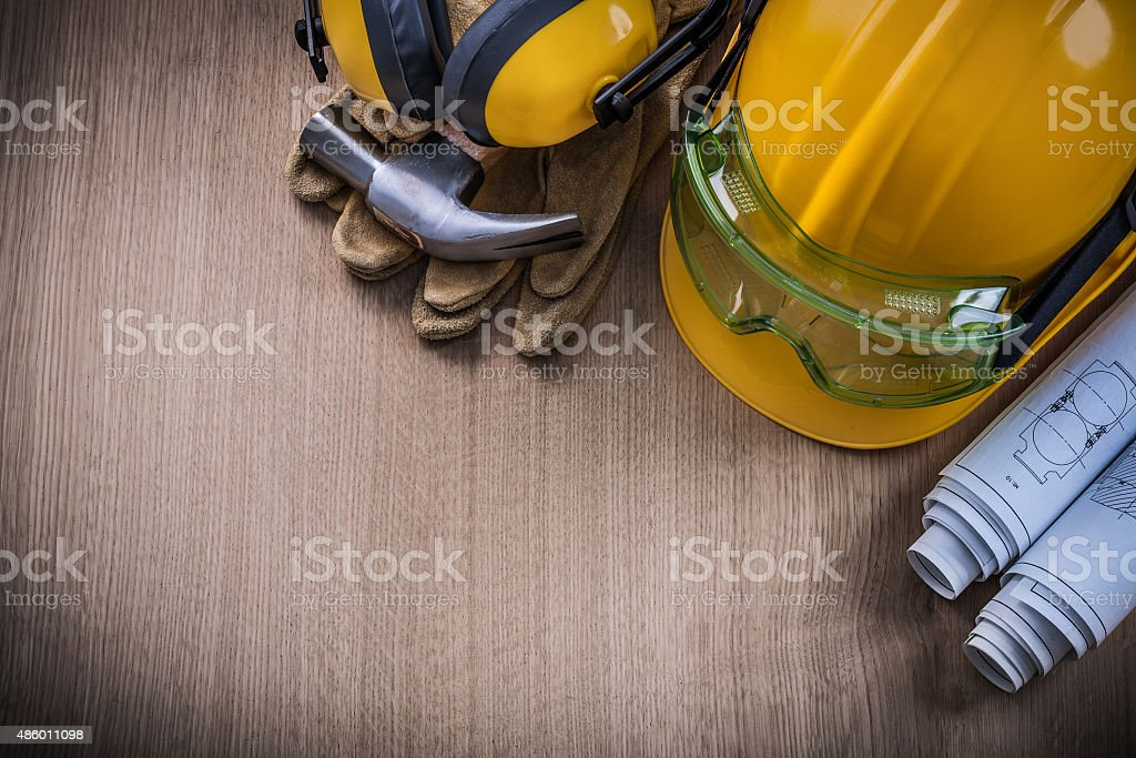Hammer safety glasses blueprints protective gloves hard hat earm stock photo