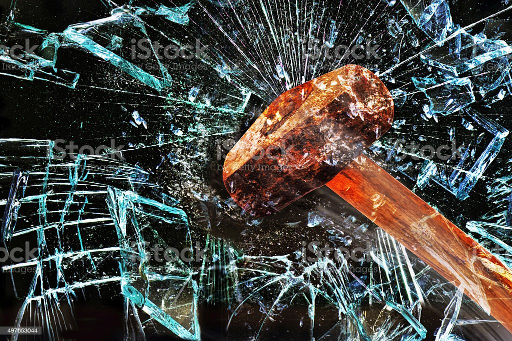 Hammer Through Window. stock photo