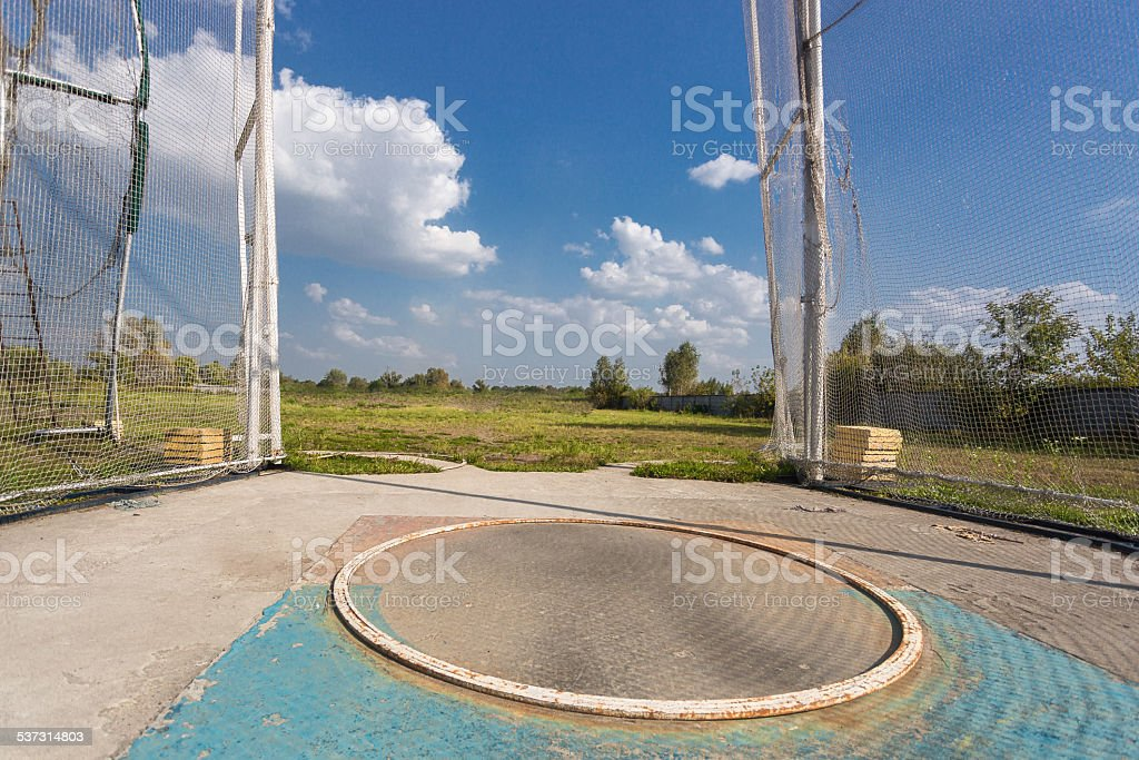 hammer throw cage at sunny day stock photo
