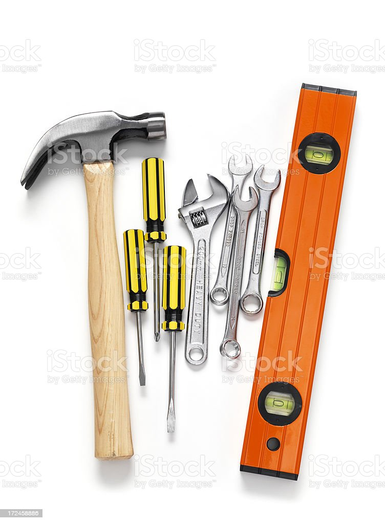 Hammer with screwdrivers, wrench and level royalty-free stock photo