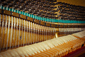 Hammers and strings inside the piano