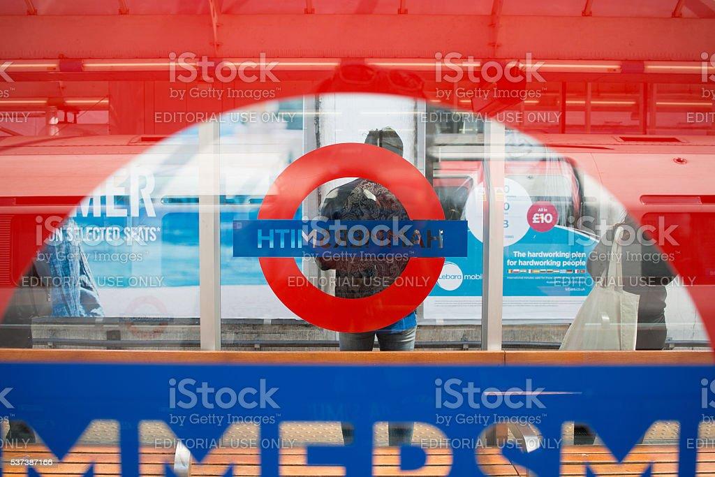 Hammersmith Station. Man waiting for tube train at station platform. stock photo