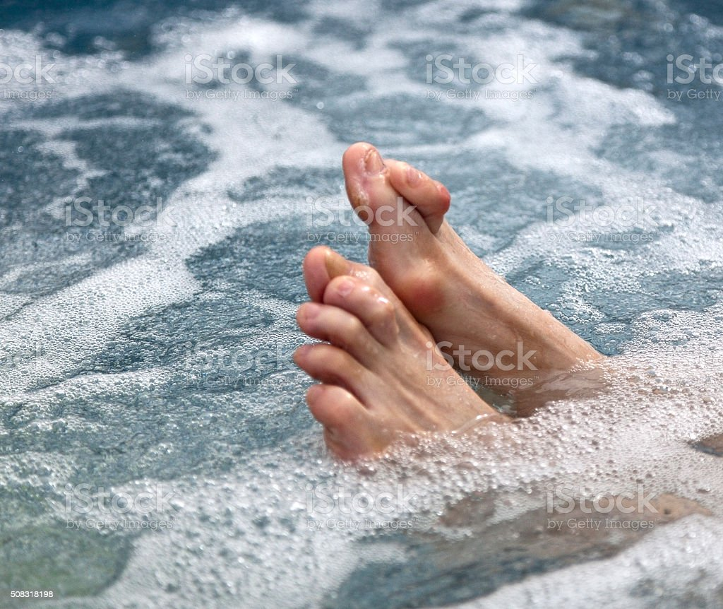 Hammertoes and Bunions in the Surf stock photo