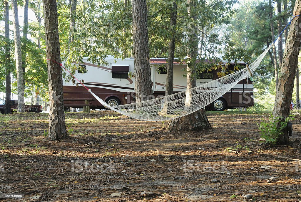 Hammock and motorhome in campground stock photo