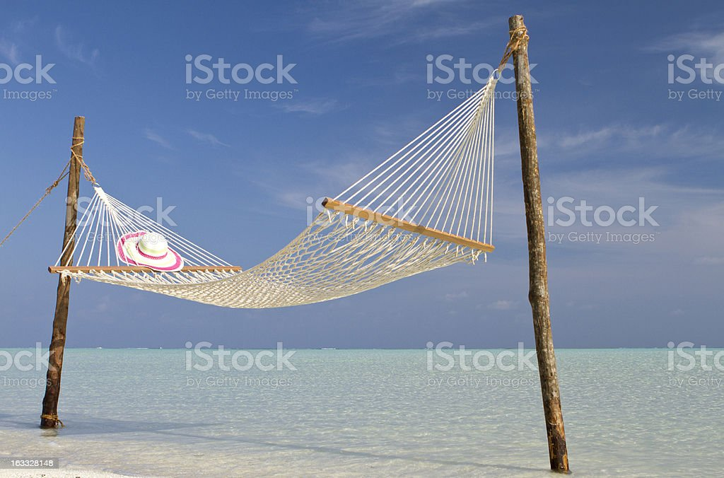 Hammock in paradise water on the beach royalty-free stock photo