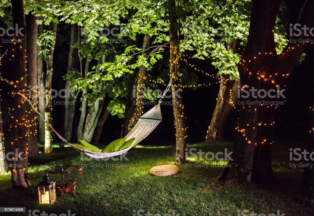 Hammock in the woods at night stock photo