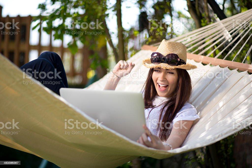 hammock laptop woman royalty-free stock photo