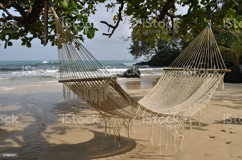 Hammock on a remote tropical beach stock photo