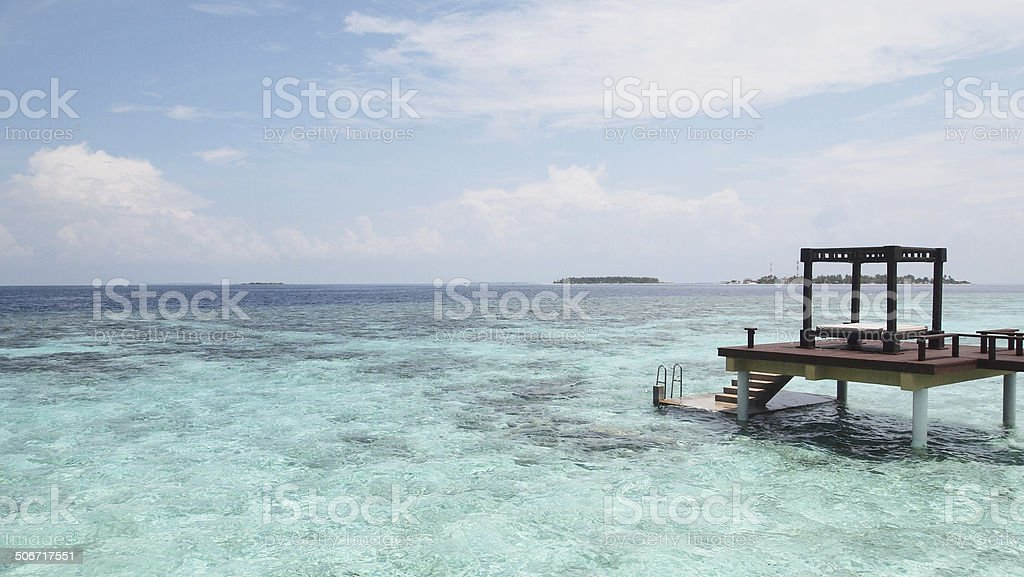 Hammock on the atoll in Maldives stock photo